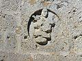 La Chapelle-Faucher église sculpture au-dessus portail.JPG