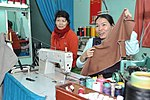Le Thi Het receives support to boost her income from sewing. (6586864279).jpg