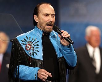 "Lee Greenwood - Greenwood performing ""God Bless the USA"" at the Conservative Political Action Conference (CPAC) in March 2013."