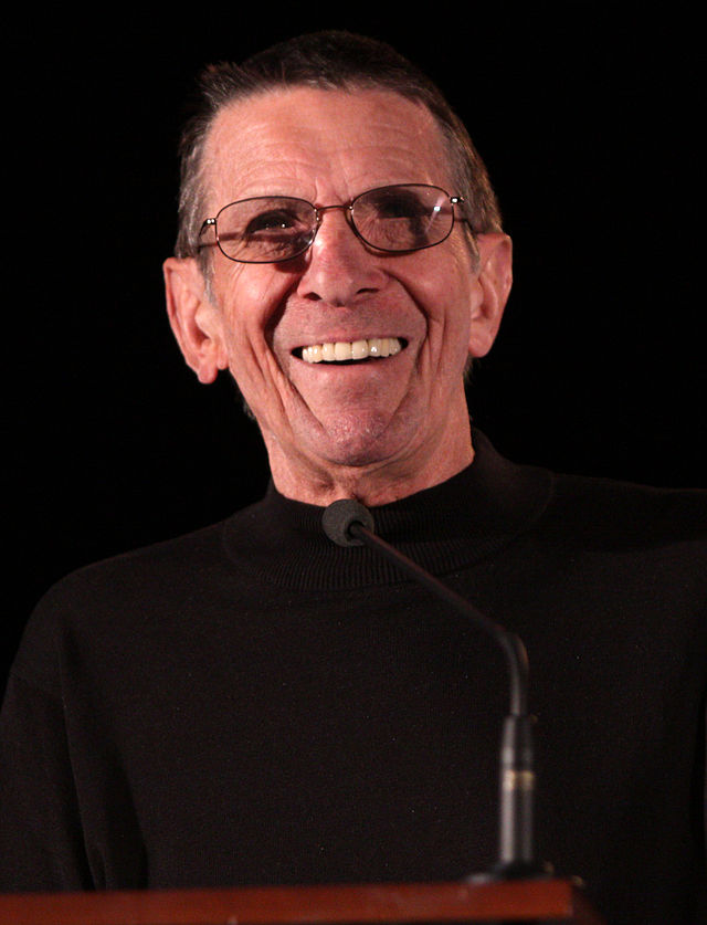 Leonard Nimoy, smiling at a lectern