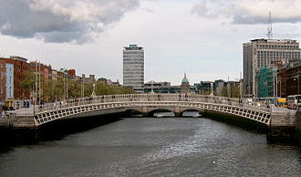 Liberty Hall - Liberty Hall, Dublin's third tallest storeyed building, stands in the background; in the foreground is the Ha'penny Bridge.