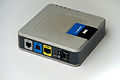 Linksys ADSL Modem AM300 ethernet, USB, and phone line ports.jpg