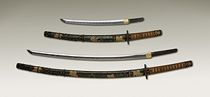 Katana - Antique Japanese daishō, the traditional pairing of two Japanese swords which were the symbol of the samurai, showing the traditional Japanese sword cases (koshirae) and the difference in size between the katana (bottom) and the smaller wakizashi (top).