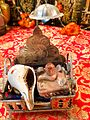 Lord Shiva Images - An image of a Shivaling alongside a conch shell in a puja setup at an Indian home.jpg