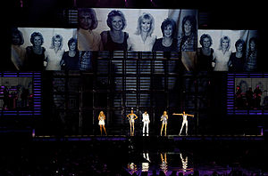 """Mama (Spice Girls song) - The group performing """"Mama"""" at the Air Canada Centre in Toronto, Canada, during the Return of the Spice Girls tour, with the backdrop screens showing a picture of their mothers."""