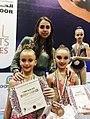 Margarita Mamun with young gymnasts.jpg