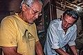 Men repairing an engine, San Juan Bautista, Nueva Esparta, Venezuela.jpg