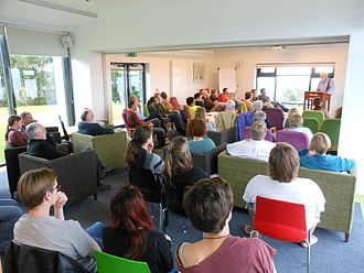 Michael Longley - Michael Longley reading his poetry at the Corrymeela Peace Center in Ballycastle, Northern Ireland, July 2012.