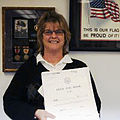 Michelle Gatz holds the logbook of the Schuyler Otis Bland.jpg