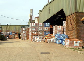 Brickyard - Bricks stacked up on pallets in a yard in Michelmersh, Hampshire, England