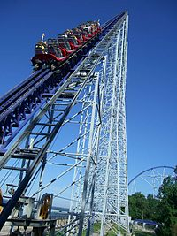 Roller coaster train ascending a steel structure