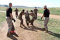 Mongolian service members run through a pepper spray qualification course during Non-Lethal Weapons Executive Seminar (NOLES) 13 at Five Hills Training Area, Mongolia, Aug. 21, 2013 130821-M-DR618-147.jpg