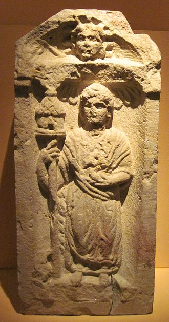 Nantosuelta - A depiction of Nantosuelta from Speyer, showing her distinctive sceptre and birds. The head of Sol can be seen in the tympanum.