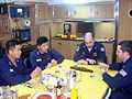 Navy officers learning cribbage.jpg