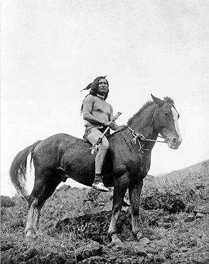 Nez Perce warrior on horse, 1910.