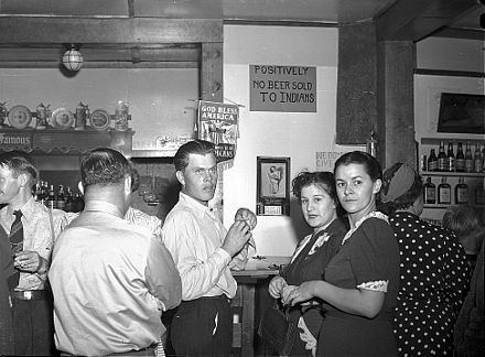 A discriminatory sign posted above a bar. Birney, Montana, 1941 No beer sold to indians.jpg