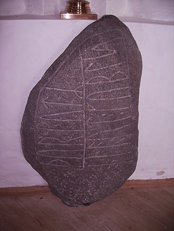 "The ninth-century Norre Naera Runestone from the Danish island of Fyn is inscribed with a ""grave binding inscription"" used to keep the deceased in its grave. Noerre Naeraa Kirke Runesten.jpg"