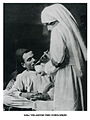 Nurse providing a meal to a wounded Ottoman soldier.jpg