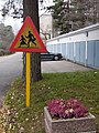 Old children warning road sign in Helsinki.jpg