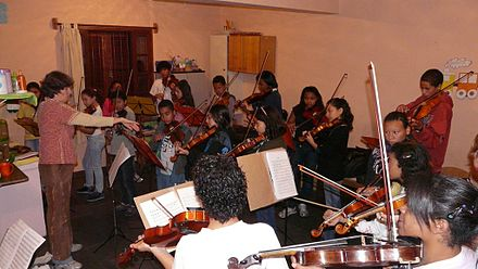 An orchestra with children and youths of the Favela. The instruments originate mainly from German donors Orchester.JPG