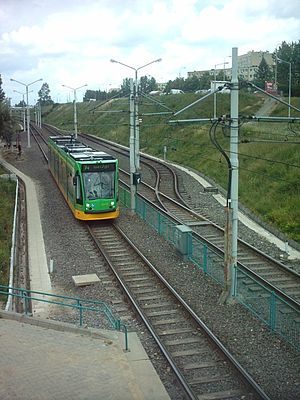 Poznań Fast Tram - A line 14 Siemens Combino approaching a PST station