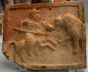 Cataphract - A stone-etched relief depicting a Parthian cataphract fighting against a lion. Housed in the British Museum.