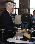 Pearl Harbor Survivor Ambrose Ferri, from Waukegan, Ill., conducts a Two-Bell Ceremony Memorial Tribute for the seven Chicago Sailors and Marines who sacrificed their lives aboard the battleship USS DVIDS134858.jpg