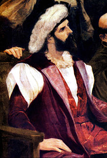 Half-length portrait of a bearded man wearing a hat with a large feather.