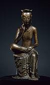 Patung Bodhisattva Maitreya bermeditasi yang terbuat dari perunggu.