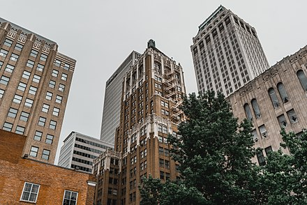 The Philtower, built in the late Gothic Revival style, is surrounded by contemporary office buildings. Philtower-Building-Tulsa-Oklahoma.jpg