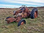 Photogenic tractor at Waternish, 5 km from Trumpan, Highland, Great Britain. – Maybe it's the colour. Maybe it's the remote location. This tractor really looks like it is happy to be abandoned here, with its view over the Little Minch to the Outer Hebrides. – The tractor is a Zetor – probably a 3011, built by the Zetor Tractor Factory Company in Brno, Czech Republic between 1958 and 1966. Zetor are still very popular especially in livestock areas. They do mainly 4x4 quite compact models which are handy to squeeze in and out of smaller buildings and work on hillsides. They were at the forefront of important innovations in the early years (like the 4 wheel drive on smaller models). The company is now owned partly by VW and has connections with John Deere. Recent models are very competent modern tractors but still with a basic ruggedness - e.g. no computers controlling things in the cab, unlike many more mainstream brands.