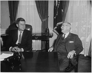 Photograph of President John F. Kennedy confer...