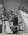 Placing concrete in the cut-off wall on the axis of the dam on the west side of the spillway structure - NARA - 295311.tif