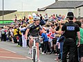 Police Officers High Five during Olympic Torch Relay.jpg