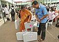 Polling officials carrying the Electronic Voting Machines (EVMs) and other necessary belongings for use in the General Elections-2014, at the distribution centre, in Visakhapatnam, Andhra Pradesh on May 06, 2014 (1).jpg