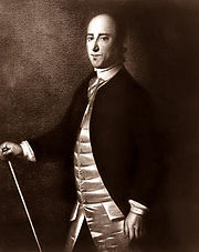 A black and white portrait of Christopher Gadsden, standing in civilian dress with a cane
