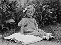 Portrait of a toddler girl seated on the grass (AM 85179-1).jpg