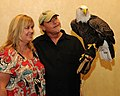 Posing for picture with Bald Eagle. (10596339114).jpg