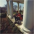 President Kennedy plays with son John F. Kennedy, Jr. White House, West Wing Collonade - NARA - 194251.jpg