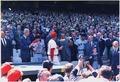 President Nixon throwing out the first ball on opening day of the 1969 baseball season between the Washington... - NARA - 194284.tif