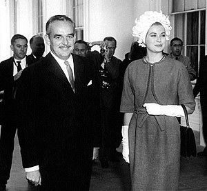 Rainier III, Prince of Monaco - Prince Rainier III and Princess Grace arrive at the White House for a luncheon, 24 May 1961