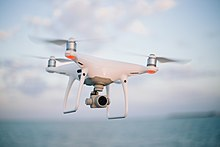 Quadcopter camera drone in flight