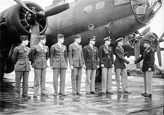 Curtis LeMay - Colonel Curtis LeMay officially congratulates a bomber crew of the 306th Bomb Group in front of their B-17 Flying Fortress at Chelveston Airfield, England, 2 June 1943.