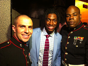 Robert Griffin III - Griffin (center) posing with two marines at the 2012 NFL draft.