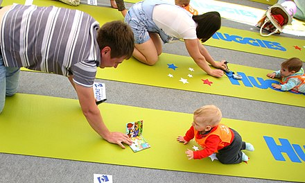 Participants compete at the baby crawling contest held in Volgograd ahead of International Children's Day, 2011. RIAN archive 916566 Volgograd holds first baby crawling contest.jpg