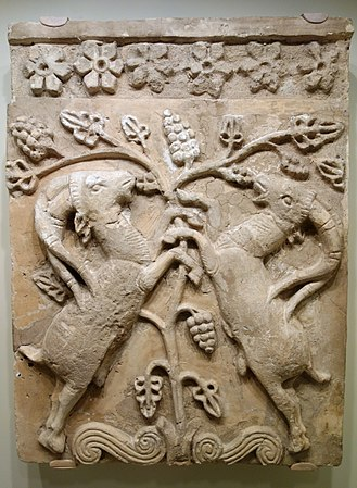 Tree of life - Confronted animals, here ibexes, flank a Tree of Life, a very common motif in the art of the ancient Near East and Mediterranean