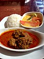 Rendang Beef curry served with coconut milk braised vegetables and rice.jpg