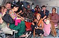 Rescued pilgrims and tourist from Harsil sitting in an IAF helicopter, during their relief & rescue operation, at Dharasu, Uttarakhand.jpg