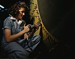 Riveter at work on Consolidated bomber, Consolidated Aircraft Corp. 1a34953v (cropped).jpg