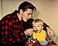 Robert Mitchum feeding Christopher Mitchum, 1946.jpg